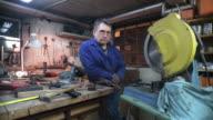 HD DOLLY: Toolmaker Posing In His Workshop