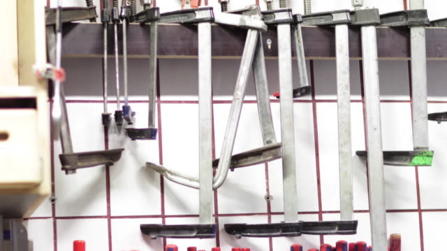 Tools hanging on wall in workshop