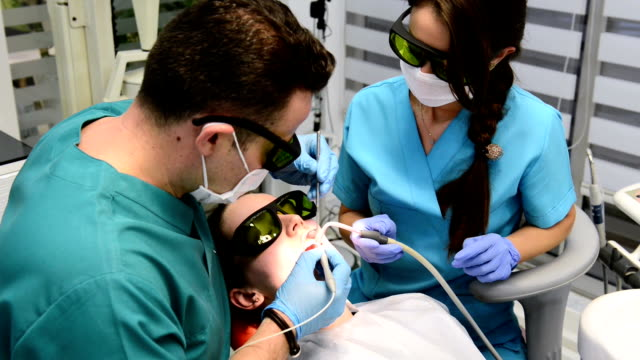 Tooth whitening in dentist office