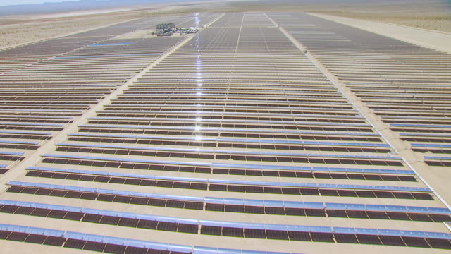 WS AERIAL POV Top down view of Large solar array reflectors in desert valley / California, United States