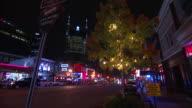Top half of ATT Building tree decorated w/ lights FG TD XWS Restaurants honky tonk bars along Broadway light traffic FG The District Lower Broadway