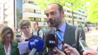 A top Macron ally facing heat over a property deal gains heavyweight support from French Prime Minister Edouard Philippe