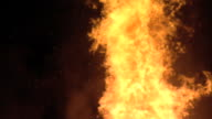 WS Top of flame w/ ashes rising from fire SLO TD Jumping dancing flames MS Top section of bonfire pile some material not yet burning