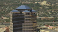 MS AERIAL Top of skyscraper building with the city/ Tucson, Arizona, United States