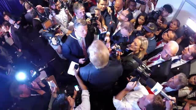 Top shot of US Republican presidential candidate Donald Trump as he is surrounded by press asking him questions