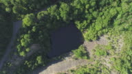 Top view, directly above aerial view to the lake at the bottom of the abandoned open cast mine in Pennsylvania