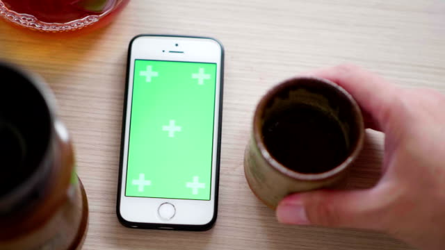 Top View Green Screen Smartphone and coffee drip