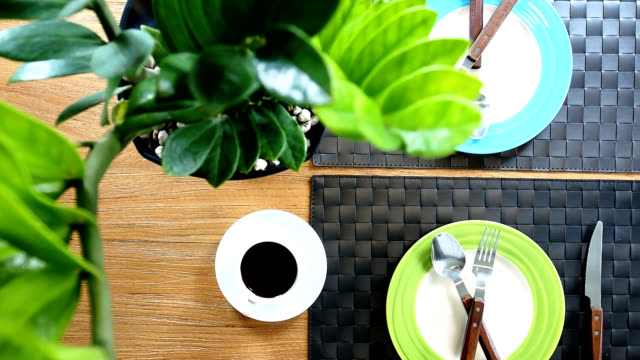 Top view of dining table with dishware