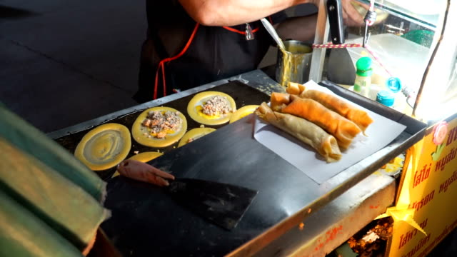 top view of street food about Egg and pork with sausage wrapped up with flour