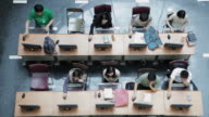 WS Top View of Student using computer in Beijing University Library / Beijing, China