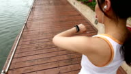 Top view of young woman run and looking wear smart watch device
