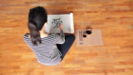 WS Top View Young woman writing chinese calligraphy artwork in  studio