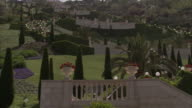 Topiaries and flowers fill the Bah+í'+¡ terraced gardens. Available in HD