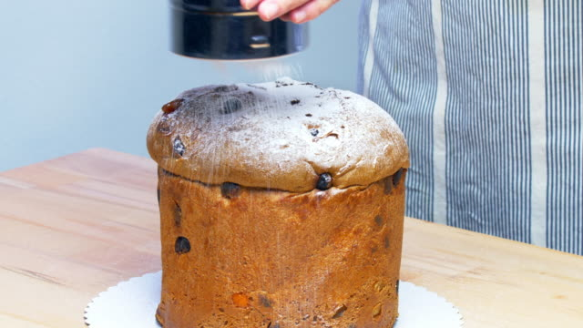 Topping Christmas Panettone With Powdered Sugar