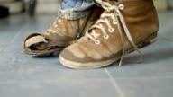 torn children's shoes