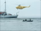 salvage operation to recover wreckage AT SEA IRISH SEA Royal Navy mine sweepers keeping station / MS Diving symbol on funnel of Royal Navy diving...