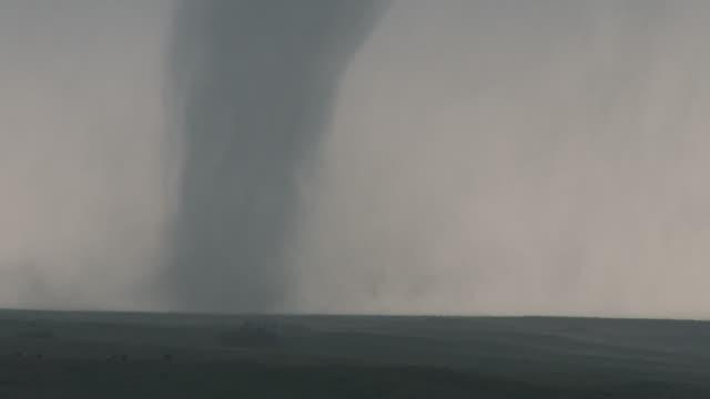 Tornado On The Ground Tearing Across Rural Farmland