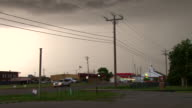 Tornado sirens wail in the town of Piedmont OK signaling the approach a violent thunderstorm during the height of tornado season