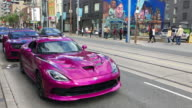Toronto, Canada: Exotic cars in Queen Street West, urban lifestyles