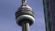Toronto, Canada: from CN Tower in blue clear sky, zoom out. The urban landmark is a major tourist attraction in the capital city of the province of Ontario