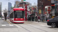 Toronto, Canada: New Bombardier streetcar in Spadina Avenue plus the everyday lifestyle in the city's Chinatown.