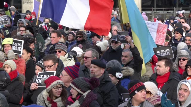 Toronto people meets in the Je Suis Charlie vigil at Nathan Phillips Square to honor the victims of the Charlie Hebdo magazine shootings and to...