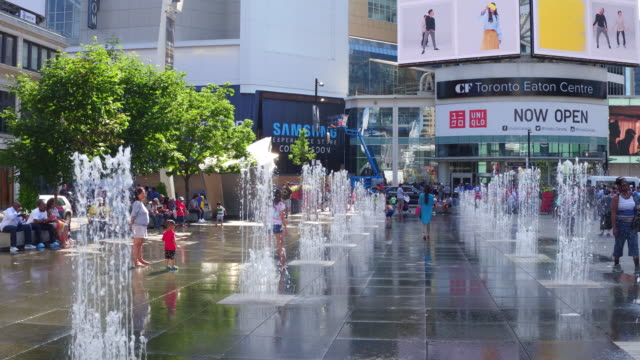 Toronto,Canada: Dundas Square fountains opened during Summer season. City outdoors lifestyle recreation during day in the famous place, cultural hub and tourist attraction in the Canadian city capital of the province of Ontario
