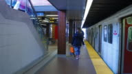Toronto,Canada: Kipling Subway Station, walking commuter point of view. Old Bombardier train to the left waiting the departure time.