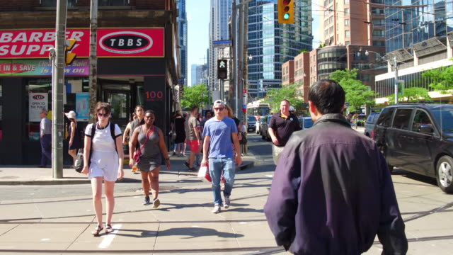 Toronto,Canada: Point of view of Yonge street, walking in the downtown district of the Canadian city