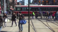 Toronto,Canada: Spadina Street, point of view image from traditional city streetcar. Old Bombardier streetcar and pedestrians in the scene