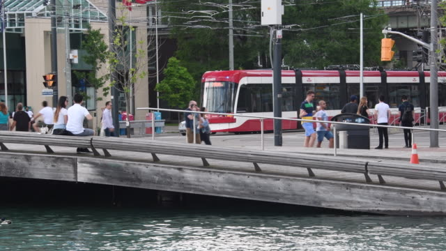 Toronto,Canada: Waterfront Harbourfront wavedecks and modern Bombardier streetcar. Everyday lifestyle in the recreational area and famous place in the Canadian city