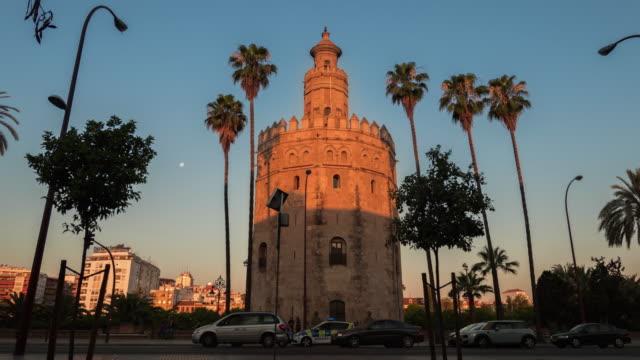 torre del oro amanecer timelapse con sombras moviendose