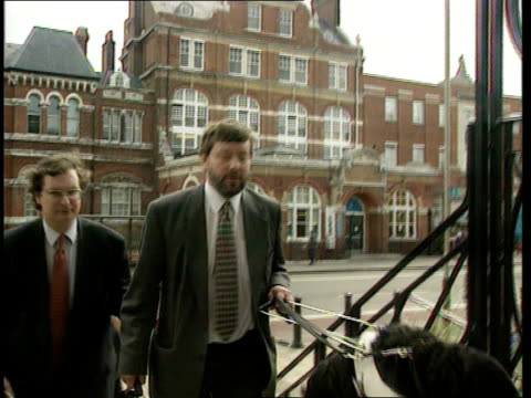 Tory Party advertising campaign ITN South London MS Shadow employment spokesman David Blunkett MP with guide dog along up steps into lab Pty HQ