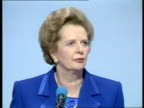 Thatcher's speech ENGLAND Bournemouth International Ctr Conf Reps seated in hall man doing backward somersault Reps clapping dancing Margaret...
