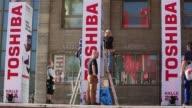 Toshiba banners hang outside the entrance to the exhibition hall ahead of the opening of the IFA 2014 Consumer Electronics Fair in Berlin Germany on...