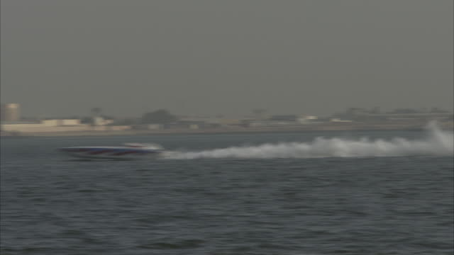 MS POV Toss speed boats race through water / Doha, Qatar