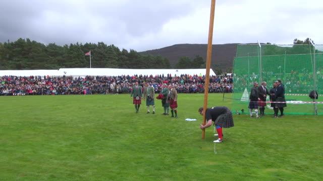 MS PAN Tossing Caber at braemar royal highland games / Braemar, Aberdeenshire, Scotland