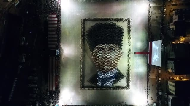 A total of four thousand people wearing Ataturk Tshirts perform Zeybek dance and form a giant portrait of the Turkish Republic's founder Mustafa...
