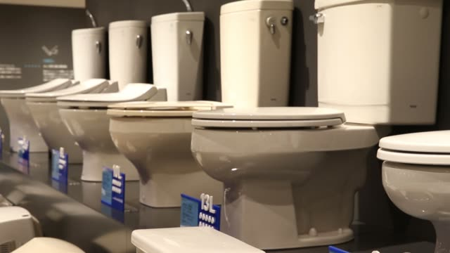 Toto Ltd toilet seats are displayed at the Toto Museum in Kitakyushu Fukuoka Japan on Tuesday Jan 24 Close up a urinal manufactured in the Meiji...
