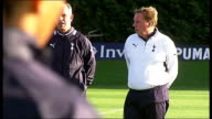 Chigwell Essex EXT GVs Harry Redknapp talking to young men then entering building / Luka Modric on pitch / Redknapp walking along at training ground...