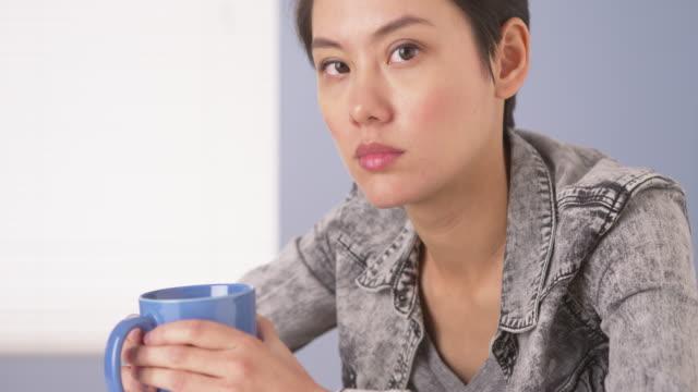 Tough woman looking at camera