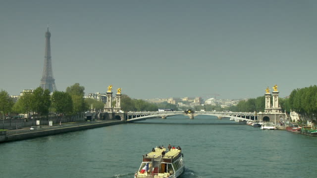 WS HA Tour boat approaching Pont Alexandre III, Eiffel Tower in background, Paris, France