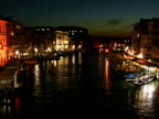 T/L HA WS Tour boats and gondolas traveling on Grand Canal at night / Venice, Italy
