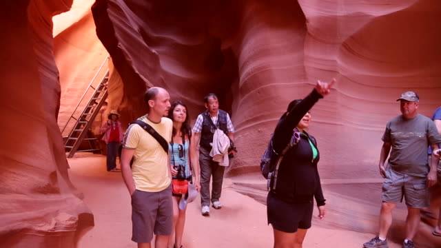 A tour guide leads a group through the Lower Antelope Slot Canyon in Page, Arizona.