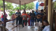 Music band playing traditional Cuban tune to tourists visiting a bar and restaurant in the Las Tunas city center Clip contains audio The urban...