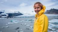 Tourist admiring glacial lagoon