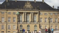 WS, DS, Tourist  at Amalienborg Palace Square and statue of Frederick V, Copenhagen, Denmark