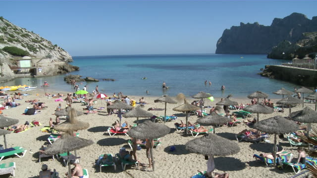 WS Tourist at beach / Cala San Vincente, Mallorca, Spain