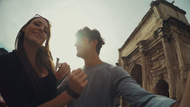 Tourist couple taking a selfie in Rome