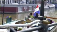 Tourist Couple taking Selfie on Amsterdam House Boat